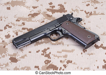 colt 1911 handgun on US Marines camouflage uniform - colt...