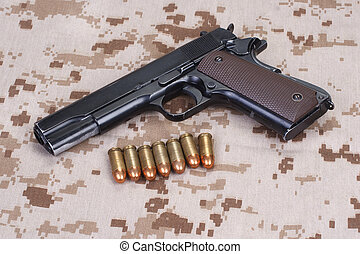 colt 1911 handgun on USMC camouflage uniform - colt 1911...