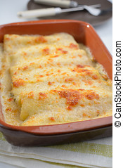 Cannelloni with spinach and ricotta in a baking dish
