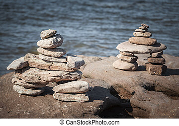 Two stacked stone cairns - Two small stacked inuksuk or...