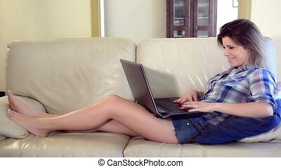 cute girl chatting on her laptop ly