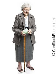 Senior woman counting money standing on white