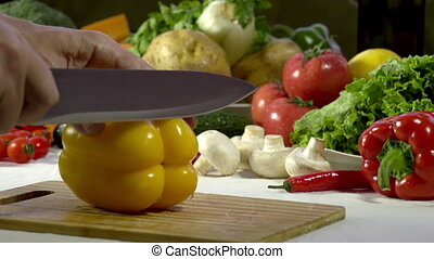 Cutting Knife Bell Pepper - Hands cook cut into large yellow...