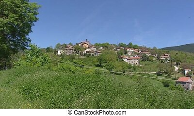 Italy - Tuscan landscape, village on hillside pan - TUSCANY,...