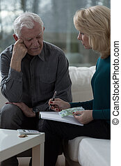 Worried husband - Elderly worried husband talking with his...