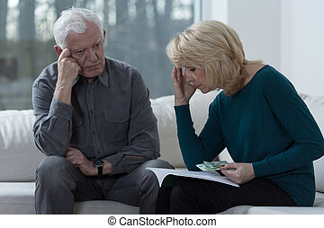 Troubled couple - Picture of older couple troubled by...