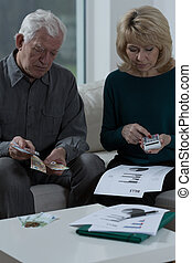Checking the bills - Elderly worried marriage checking the...