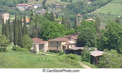 Tuscan village on hillside with Cypress trees - TUSCANY,...