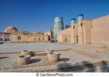 Khiva - Gate and surrounding walls in old town of Khiva,...
