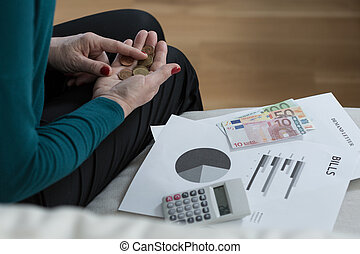 Penniless woman - Close-up of penniless older woman counting...
