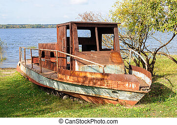 Old rusty motorboat - Old abandoned rusty motorboat on the...