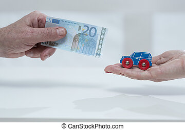 Car fee - Close-up of mans hand holding the car fee
