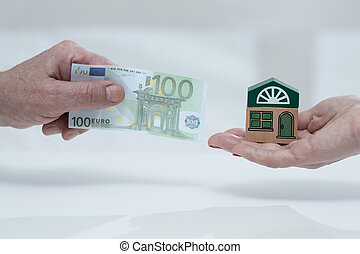 House fee - Close-up of man holding monthly house fee