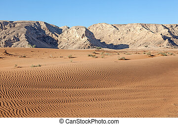 Hajar Mountains and desert landscape in Fujairah, United...