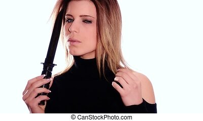 woman with knife - Young beautiful woman playing a sexy game