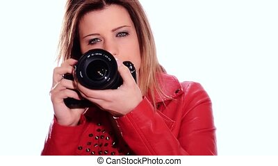 girl taking a photo - Pretty young woman taking photos with...