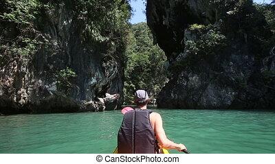 man rowing kayak in the gorge