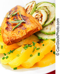 Baked whitefish with orange juice and boiled potatos as side...