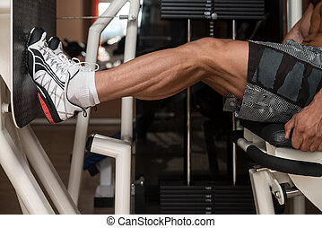Bodybuilder Doing Legs Exercise - Bodybuilder Doing Heavy...