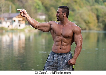 Bodybuilder Showing His Well Trained Body - Attractive Man...