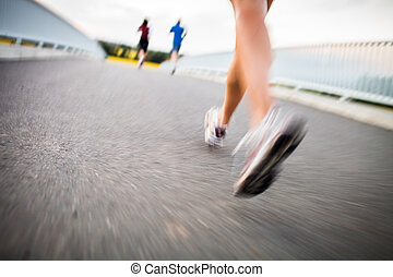Young woman jogging outdoors motion blurred image