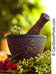 Mortar and pestle on the wooden table