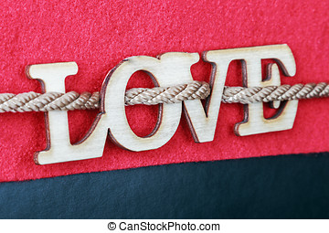 carved wooden letters love on a red background