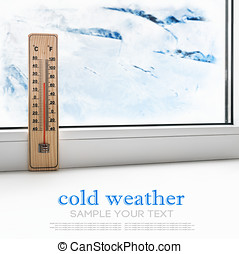 Thermometer on a frozen window and cold weather outside The...