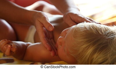 child lies on bed - small blonde baby girl lies on bed and...
