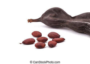 The Ripe Carob on the white background