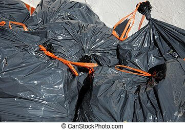 Garden rubbish bags. - Grey bin bags of garden waste with...