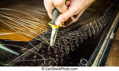 Dismantling Process of Old Piano Strings With Pliers -...