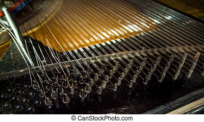 Dismantling Process of Old Piano Strings - Close-up shot of...