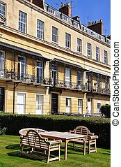 Royal Mews, Cheltenham. - Wooden table and chairs outside...