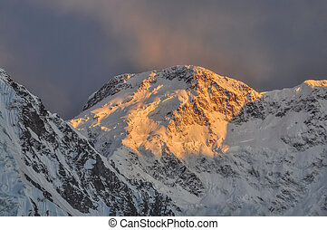 Kyrgyzstan mountains - Scenic Pik Pobeda peak lit by early...