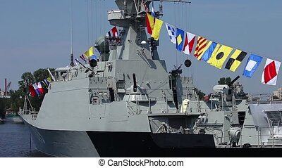 military naval flags on a warship - frigate Makhachkala...