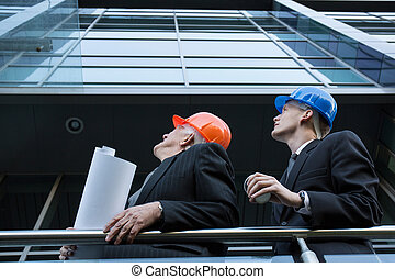 Engineers supervising construction site - Image of engineers...