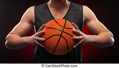 Close up of male basketball athlete gripping the ball -...