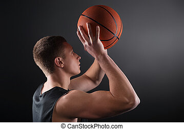 Caucasian male basketball player free throwing the ball -...
