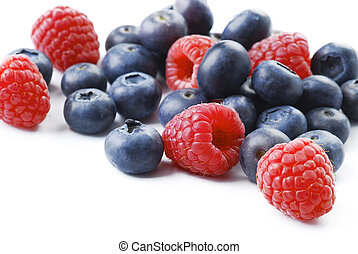 raspberries and blueberries on white