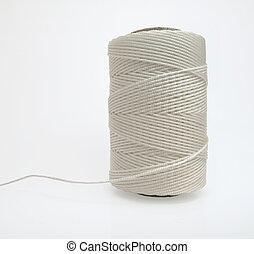 Nylon cord - White nylon cording beautifully wound on a...