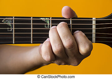 E chord on guitar - Hand performing E chord on guitar