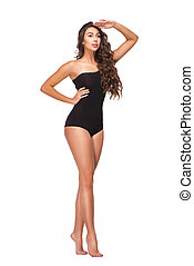 Young woman in black swimsuit