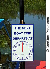 Boat trip departure sign - Boat trip departure time sign...
