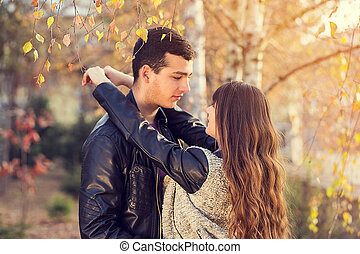 man woman couple kissing portrait sunny