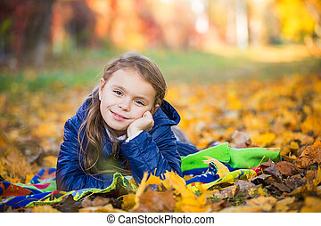 young girl lying in the park