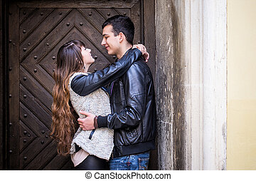 Romantic couple hugging door man woman
