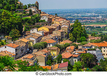 landscape with roofs of houses in small tuscan town in...