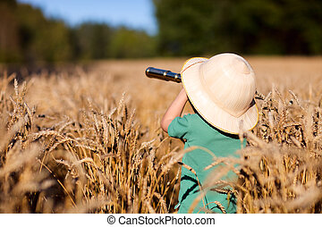 Nature explorer - Portrait of young nature explorer in wheat...