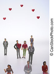 Couple man and woman and red hearts - Figurine of couple of...
